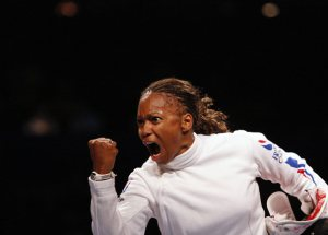 Laura Flessel Colovic of France celebrates her victory against Zhong Weiping of China during their women's individual epee fencing competition at the Beijing 2008 Olympic Games, August 13, 2008. REUTERS/Alessandro Bianchi (CHINA)